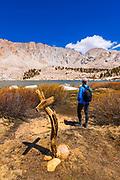 Hiker enjoying the view at Cottonwood Lake #5 under Mount Langley, John Muir Wilderness, California USA