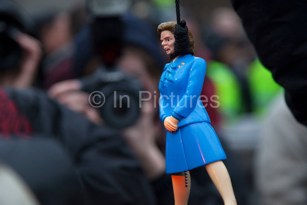 London, UK. Saturday 13th April 2013. Perople taunt a plastic effigy of Margaret Thatcher hanging from a noose as if being executed as hundreds of people gather for the Margaret Thatcher Death Party in Trafalgar Square, to celebrate the late Prime Minister's passing away.