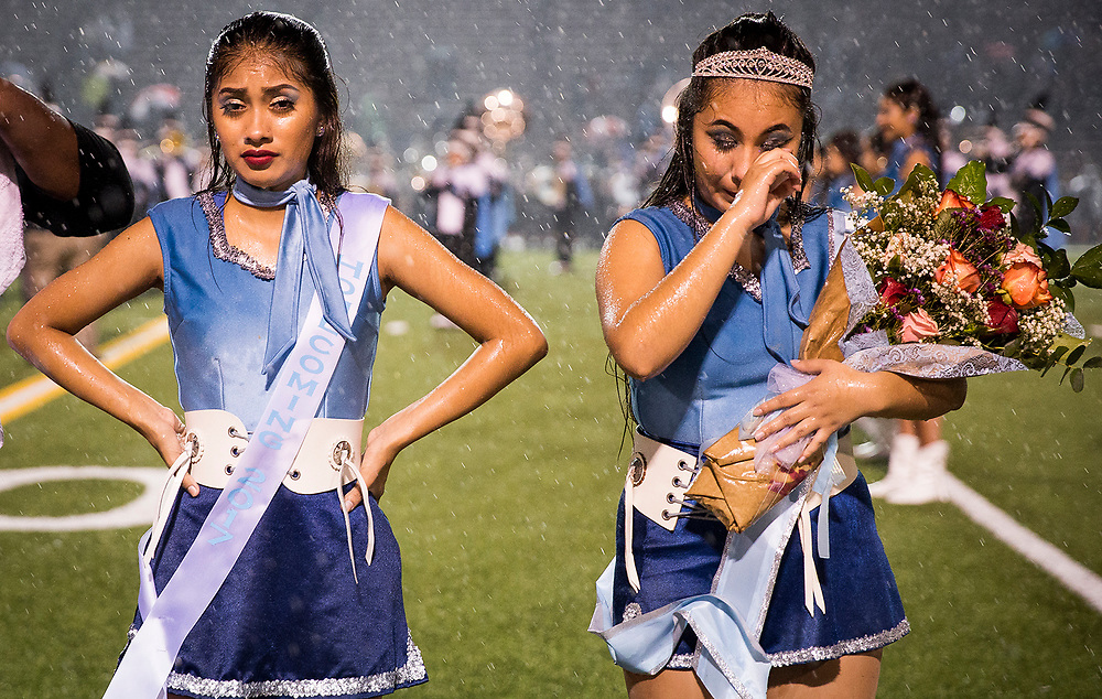 The Double R's dance team and homecoming court members Jennifer Castillo, left, and Saydeline Martinez stand before the audience during halftime of a high school football game between Lanier and Reagan on Thursday, Sept. 28, 2017, in Austin, Texas. NICK WAGNER / AMERICAN-STATESMAN