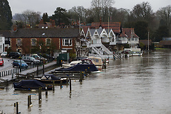 Rising waters threaten to flood the streets alongside the River Thames in Henley, Oxfordshire, as heavy rains in the catchment area and saturated ground cause the river to rise to within inches of bursting its banks.. April 02 2018.