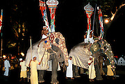 Mahouts handlers with decorated and illuminated elephants In traditional Raja Perahera Caravan Ceremony celebration In Sri Lanka