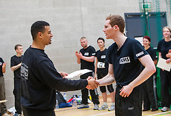 A P1 student receives his pass certificate from Franklyn Hartkamp at the Institute Of Krav Maga Scotland grading today at Stirling.<br /> ©Michael Schofield.