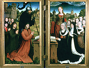 Willem Moreel (d1501) protected by St William of Maleval. and Barbara van Vlaenderberch (d1499) protected by St Barbara, the Donors and their family.  Moreel Triptych, 1494. Hans Memling (1430/1440-1494) South Netherlandish painter.