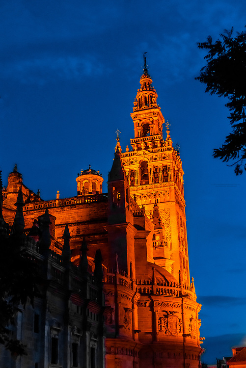 Giralda Tower and Seville Cathedral, predawn, Seville, Andalusia, Spain.