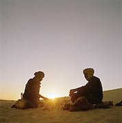 Tuareg Tribesmen by the fire at sunrise, Sahara Desert, Libya