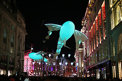 © Licensed to London News Pictures. 14/01/2016. London, UK. Giant illuminated helium filed sculptures entitled 'Les Lumineoles' float above Piccadilly. Lumiere London is a major new light festival that, over four evenings, brings together<br /> some of the world's most exciting artists working with light utilising large-scale video-mapped projections, interactive pieces and installations. Photo credit: Peter Macdiarmid/LNP