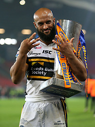 Leeds Rhinos' Jamie Jones Buchanan celebrates with the trophy after the final whistle during the Betfred Super League Grand Final at Old Trafford, Manchester.