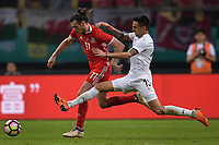 """Gareth Bale, left, of Wales national football team kicks the ball to make a pass against Matias Vecino of Uruguay national football team in their final match during the 2018 Gree China Cup International Football Championship in Nanning city, south China's Guangxi Zhuang Autonomous Region, 26 March 2018.<br /> <br /> Edinson Cavani's goal in the second half helped Uruguay beat Wales to claim the title of the second edition of China Cup International Football Championship here on Monday (26 March 2018). """"It was a tough match. I'm very satisfied with the result and I think that we can even get better if we didn't suffer from jet lag or injuries. I think the result was very satisfactory,"""" said Uruguay coach Oscar Tabarez. Wales were buoyed by a 6-0 victory over China while Uruguay were fresh from a 2-0 win over the Czech Republic. Uruguay almost took a dream start just 3 minutes into the game as Luis Suarez's shot on Nahitan Nandez cross smacked the upright. Uruguay were dealt a blow on 8 minutes when Jose Gimenez was injured in a challenge and was replaced by Sebastian Coates. Inter Milan's midfielder Matias Vecino of Uruguay also fired at the edge of box from a looped pass but only saw his attempt whistle past the post. Suarez squandered a golden opportunity on 32 minutes when Ashley Williams's wayward backpass sent him clear, but the Barca hitman rattled the woodwork again with goalkeeper Wayne Hennessey well beaten."""