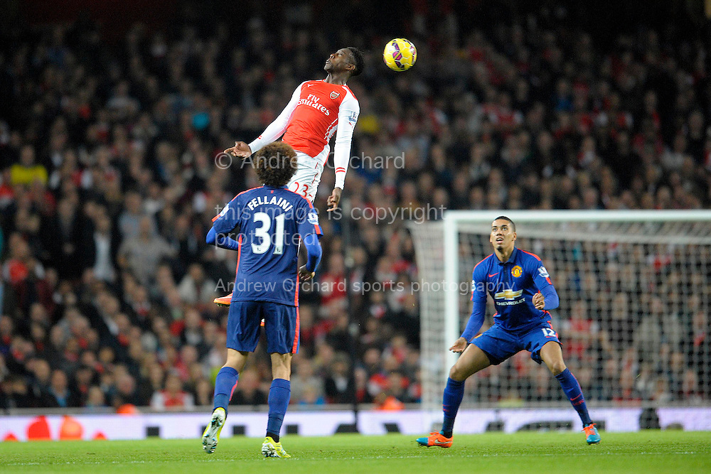 Danny Welbeck of Arsenal heads the ball. Barclays Premier league match, Arsenal v Manchester Utd at the Emirates Stadium in London on Saturday 22nd November 2014.<br /> pic by John Patrick Fletcher, Andrew Orchard sports photography.