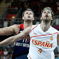 02 August 2012: Spain Pau Gasol vies for the rebound with Great Britain Joel Freeland during 79-78 Team Spain victory over Team Great Britain, during the men's basketball preliminary, at the Basketball Arena, in London, Great Britain.
