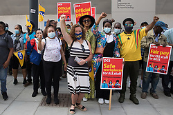 Fran Heathcote (c), National President of the PCS trade union, joins members working for the outsourced contractor ISS on the picket line outside their workplace at the Department for Business, Energy and Industrial Strategy (BEIS) on the second day of a 3-day strike on 20th July 2021 in London, United Kingdom. The striking cleaners, security guards and other support staff at the government department are demanding an end to low pay, improved working conditions, bonuses for having worked through lockdown, annual leave from last year and a Covid return-to-work protocol.