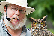 A man with his pet owl Photographed at the Indiana State Fair