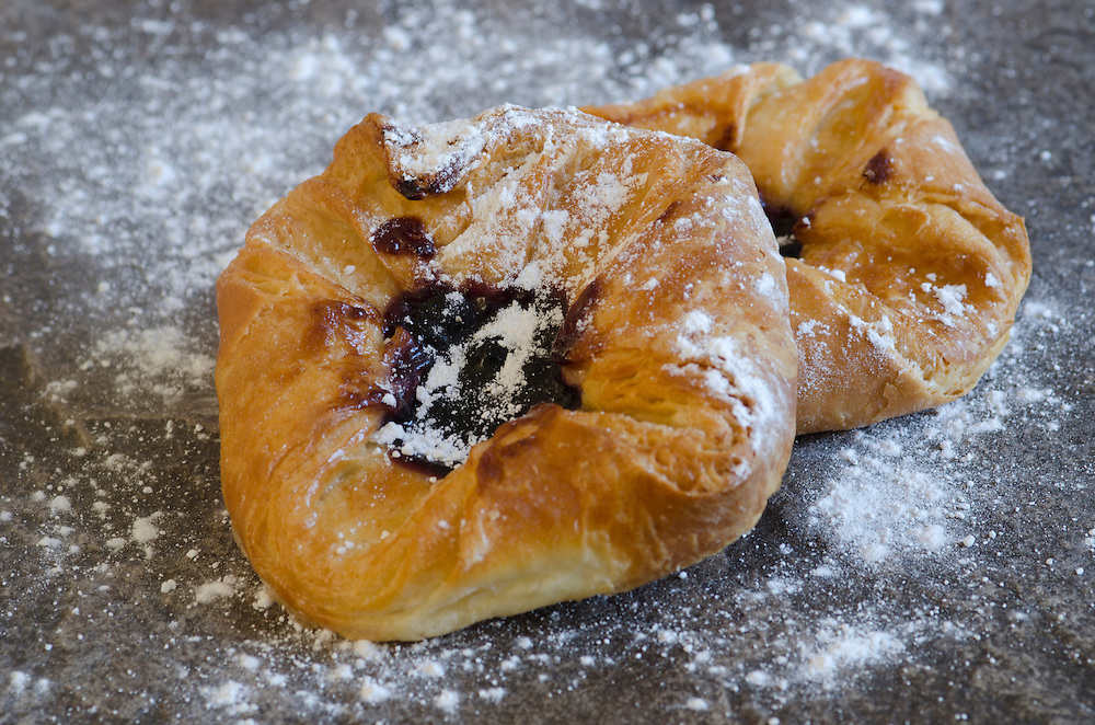 Freshly baked Fruit Danish topped with icing sugar