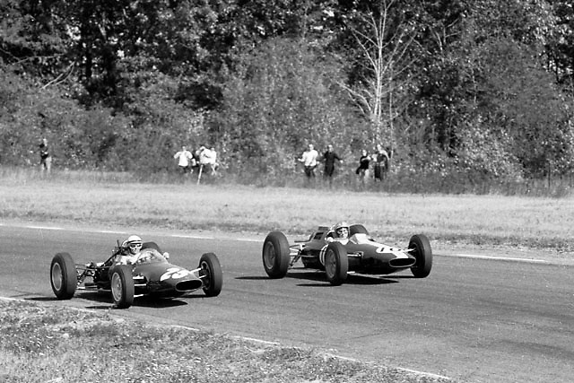 """Phil Hill (ATS 25) and Pedro Rodriguez (Lotus 10) in the """"Loop Chute"""" bend at the far end of Watkins Glen."""