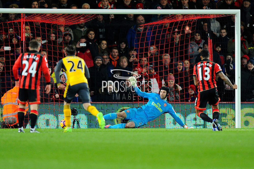 AFC Bournemouth forward Callum Wilson scores a goal from the penalty spot beating Petr Cech (33) of Arsenal to give a 2-0 lead to the home team during the Premier League match between Bournemouth and Arsenal at the Vitality Stadium, Bournemouth, England on 3 January 2017. Photo by Graham Hunt.