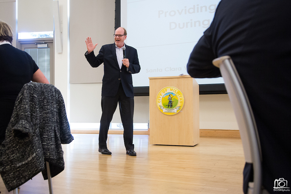 City Manager Tom Williams welcomes guests to breakfast during the Milpitas Chamber of Commerce Business Breakfast at the Milpitas Senior Center in Milpitas, California, on April 14, 2015. (Stan Olszewski/SOSKIphoto)