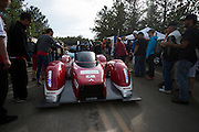 June 30, 2013 - Pikes Peak, Colorado.   Greg Tracy celebrates with fans after the 91st running of the Pikes Peak Hill Climb.