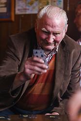 Man playing cards in Gaynor's Pub, Leenaun, County Galway, Ireland