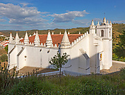 Architectural details of conical roof decorations historic whitewashed church Igreja Matrix in medieval village of Mértola, Baixo Alentejo, Portugal, Southern Europe