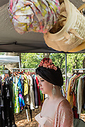 A vendor selling vintage-style hats and headpieces. Several vendors were selling 1920s- and 30s-era clothing and accessories.
