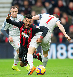Bournemouth's Joshua King tackled by Liverpool's James Milner during the Premier League match at the Vitality Stadium, Bournemouth.