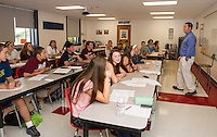 Steve McDonough with his students begin the year in their newly renovated Math Wing classroom at Laconia High School.  (Karen Bobotas/for the Laconia Daily Sun)