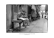 Young boys enjoying their comics at Coles Lane near Moore Street in Dublin.<br /> <br /> 23rd February 1961<br /> <br /> 23/02/1961