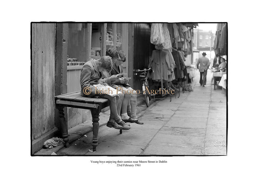 Young boys enjoying their comics at Coles Lane near Moore Street in Dublin.<br />