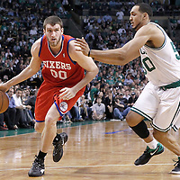 21 May 2012: Philadelphia Sixers center Spencer Hawes (00) drives past Boston Celtics center Ryan Hollins (50) during the Boston Celtics 101-85 victory over the Philadelphia Sixer, in Game 5 of the Eastern Conference semifinals playoff series, at the TD Banknorth Garden, Boston, Massachusetts, USA.