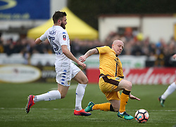 Sutton United's Nicky Bailey (right) and Leeds United's Stuart Dallas battle for the ball during the Emirates FA Cup, Fourth Round match at Borough Sports Ground, London.