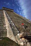 """Mayan ruins of El Castillo at Chichen Itza or """"At the mouth of the well of the Itza"""", Yucatan, Mexico. MODEL RELEASED."""