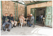 Men playing cards next to Herod's Gate in the Old City of Jerusalem