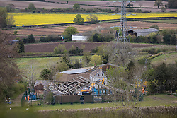 Wendover, UK. 4th May, 2021. An outbuilding is demolished for the HS2 high-speed rail link at Durham Farm in the Chilterns AONB. Felling of the nearby Jones Hill Wood, ancient woodland which contains resting places and/or breeding sites for pipistrelle, barbastelle, noctule, brown long-eared and natterer's bats and is said to have inspired Roald Dahl's Fantastic Mr Fox, has also recommenced after a High Court judge refused an application for judicial review and lifted an injunction.