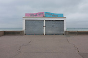 The lowered shutters of a closed beach concession wishing you were here, on 17th September 2016, on the Eastern Esplanade, at Southend, Essex, England. Southend-on-Sea is a seaside town on the north side of the Thames estuary 40 miles 64 km east of central London. In its heyday, the working class visited from the capital when train transport allowed them to enjoy its beaches and the worlds longest pier. Its splendour faded on the advent of package holidays to Spain etc.