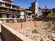 05 MARCH 2017 - KATHMANDU, NEPAL: An empty lot that used to be an apartment building in Kathmandu. The building collapsed during the 2015 earthquake. Much of Kathmandu is now a construction site because of rebuilding  two years after the earthquake of 25 April 2015 that devastated Nepal. In some villages in the Kathmandu valley workers are working by hand to remove ruble and dig out destroyed buildings. About 9,000 people were killed and another 22,000 injured by the earthquake. The epicenter of the earthquake was east of the Gorka district.     PHOTO BY JACK KURTZ
