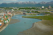 Anchorage. Chinook King Salmon fishing in Ship CReek , with Chugach Mountains in distance. Anchorage Dock in foreground.