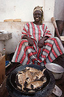 Dakar, Senegal --- Street Vendor Frying Fish --- Photograph by Owen Franken