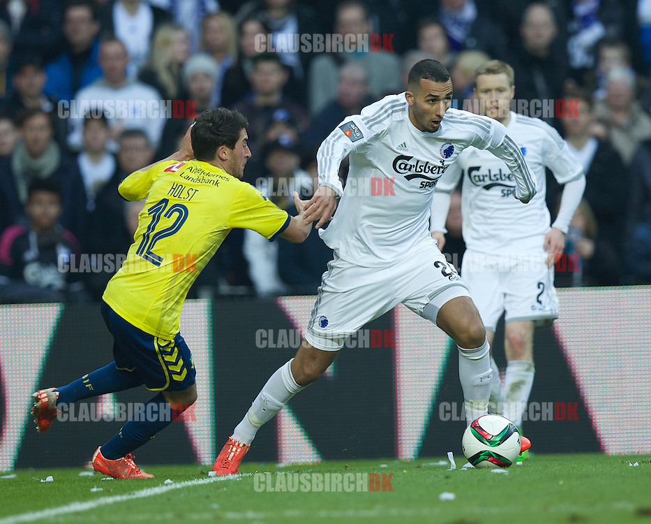 Youssef Toutouh of FC København is challenged by Frederik Holst of Brøndby IF during the Danish Alka Superliga match between FC København and Brøndby IF at Telia Parken on March 8, 2015 in Copenhagen, Denmark. (Photo by Claus Birch)