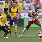 Thierry Henry, (right), New York Red Bulls, goes past Mikel Arteta, Arsenal, during the New York Red Bulls Vs Arsenal FC,  friendly football match for the New York Cup at Red Bull Arena, Harrison, New Jersey. USA. 26h July 2014. Photo Tim Clayton