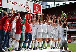 Melanie Leupolz of Bayern Munich lifts the trophy infront of the celebrating players - Mandatory by-line: Arron Gent/JMP - 28/07/2019 - FOOTBALL - Emirates Stadium - London, England - Arsenal Women v Bayern Munich Women - Emirates Cup