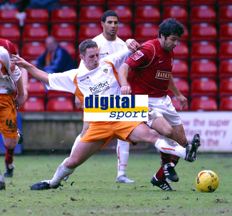Photo: Dave Linney.<br />Walsall v Blackpool. Coca Cola League 1. 31/12/2005.<br />Jorge Leitao(Walsall) is challenged by   Danny Warrender(Blackpool)
