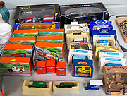 Display of collectible boxed motor vehicle model toys at auction