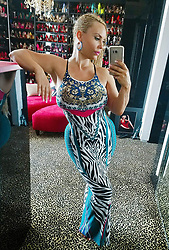 """Coco Austin releases a photo on Twitter with the following caption: """"""""Its one of those maxi dresses kinda days.I 💖 when they have cool backs too!<br /> When buying from @FashionNova  use the code """"Coco"""" get 15% off"""""""". Photo Credit: Twitter *** No USA Distribution *** For Editorial Use Only *** Not to be Published in Books or Photo Books ***  Please note: Fees charged by the agency are for the agency's services only, and do not, nor are they intended to, convey to the user any ownership of Copyright or License in the material. The agency does not claim any ownership including but not limited to Copyright or License in the attached material. By publishing this material you expressly agree to indemnify and to hold the agency and its directors, shareholders and employees harmless from any loss, claims, damages, demands, expenses (including legal fees), or any causes of action or allegation against the agency arising out of or connected in any way with publication of the material."""