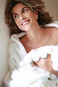 Smiling woman in a white gown at a SPA Model release available