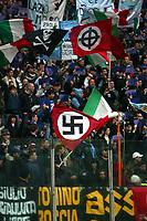 Fotball<br /> Serie A Italia 2004/05<br /> Lazio v Livorno<br /> 10. april 2005<br /> Foto: Digitalsport<br /> NORWAY ONLY<br /> Nazist and fascist flag in SS Lazio stands