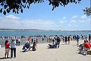 San Diego, California. USA. Spectators watch the racing from the beach at the 2013 Crew Classic Regatta, Mission Bay.  13:56:45.  Saturday  06/04/2013   [Mandatory Credit. Peter Spurrier/Intersport Images]  ..