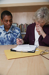 Boy in consultation with a social worker,