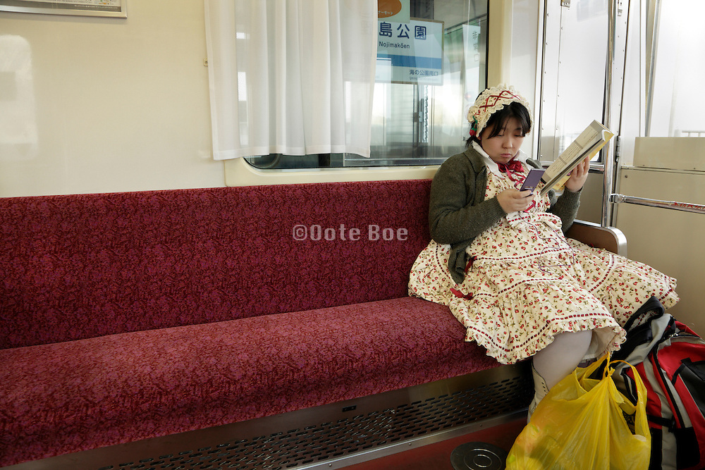 young adult obese Japanese girl in Lolita style clothing sitting alone