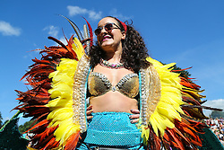 © Licensed to London News Pictures. 29/08/2016. Leeds, UK. A colourfully dressed woman at Leeds West Indian Carnival in Leeds, West Yorkshire. First run in the 1960's, the Leeds West Indian Carnival is Europe's longest running authentic Caribbean carnival parade. Photo credit : Ian Hinchliffe/LNP