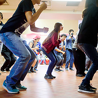 Ramona Andis, center, and other learn new dance moves during the Young Americans summer camp at Crownpoint High School May 25.